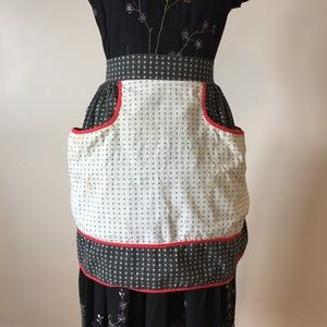 Vintage black, white and red apron with pocket.